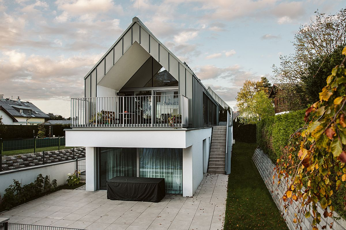 Multi-level home feels elegant and refreshing even as it shares space with its neighbor