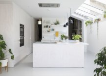 New-kitchen-and-dining-area-of-the-British-home-in-white-acts-as-an-interface-between-the-old-and-the-new-70954-217x155