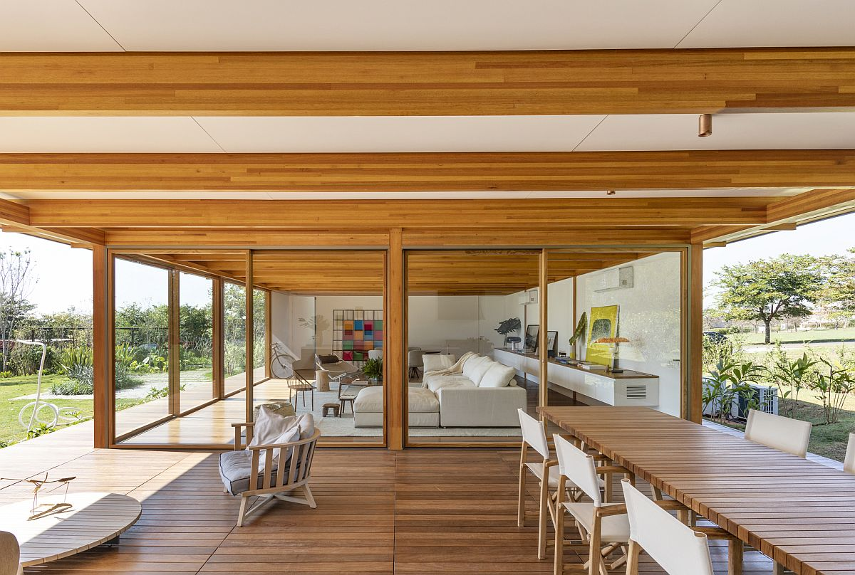 Open plan living area, kitchen and dining space of contemporary Brazilian home