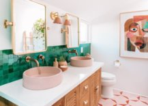 Pair-of-gold-trimmed-mirrors-over-a-pair-of-pink-sinks-15993-217x155