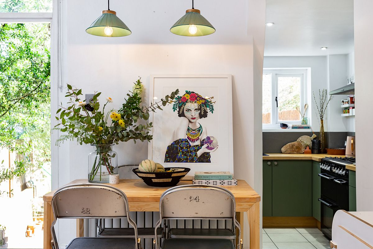 Pendants-add-green-accents-to-the-small-Scandinavian-dining-area-while-connecting-it-with-the-kitchen-56524