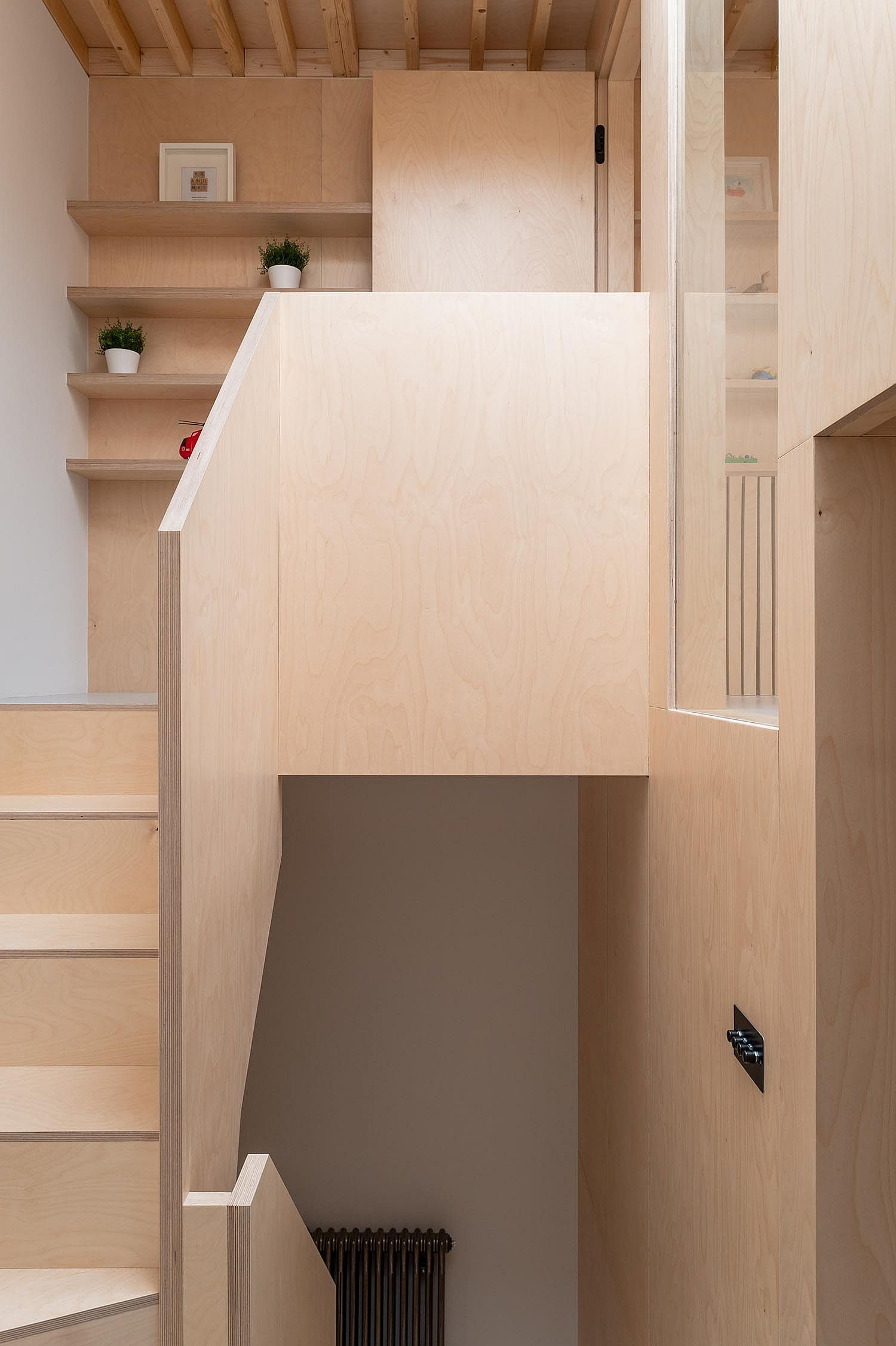 Plywood clad-walls and staircase completely alter the interior of the this London home