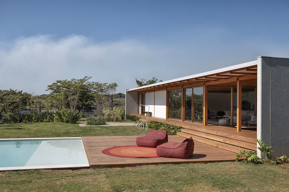 Poolside seats give the homeowners an opportunity to relax and take in the sunshine