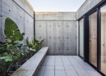 Private-concrete-courtyard-of-the-house-with-custom-bench-79772-217x155
