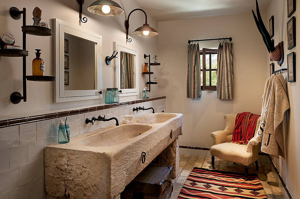 Re-purposed horse trough and antique fixtures make the biggest impact in this white bathroom