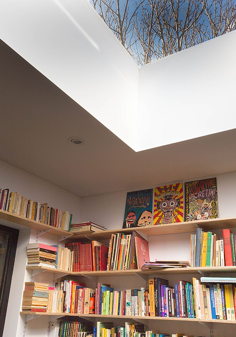 Reading lounge on the mezzanine level of the house with skylight feels both spacious and cheerful