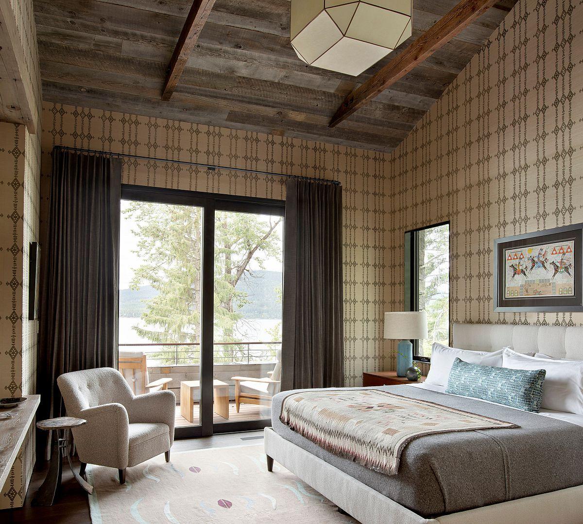 Reclaimed wood and custom wallpaper bring ample pattern to this spaciou rutic bedroom