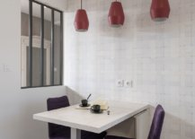 Red-pendants-add-color-and-contrastto-the-minimal-dining-room-in-white-10597-217x155