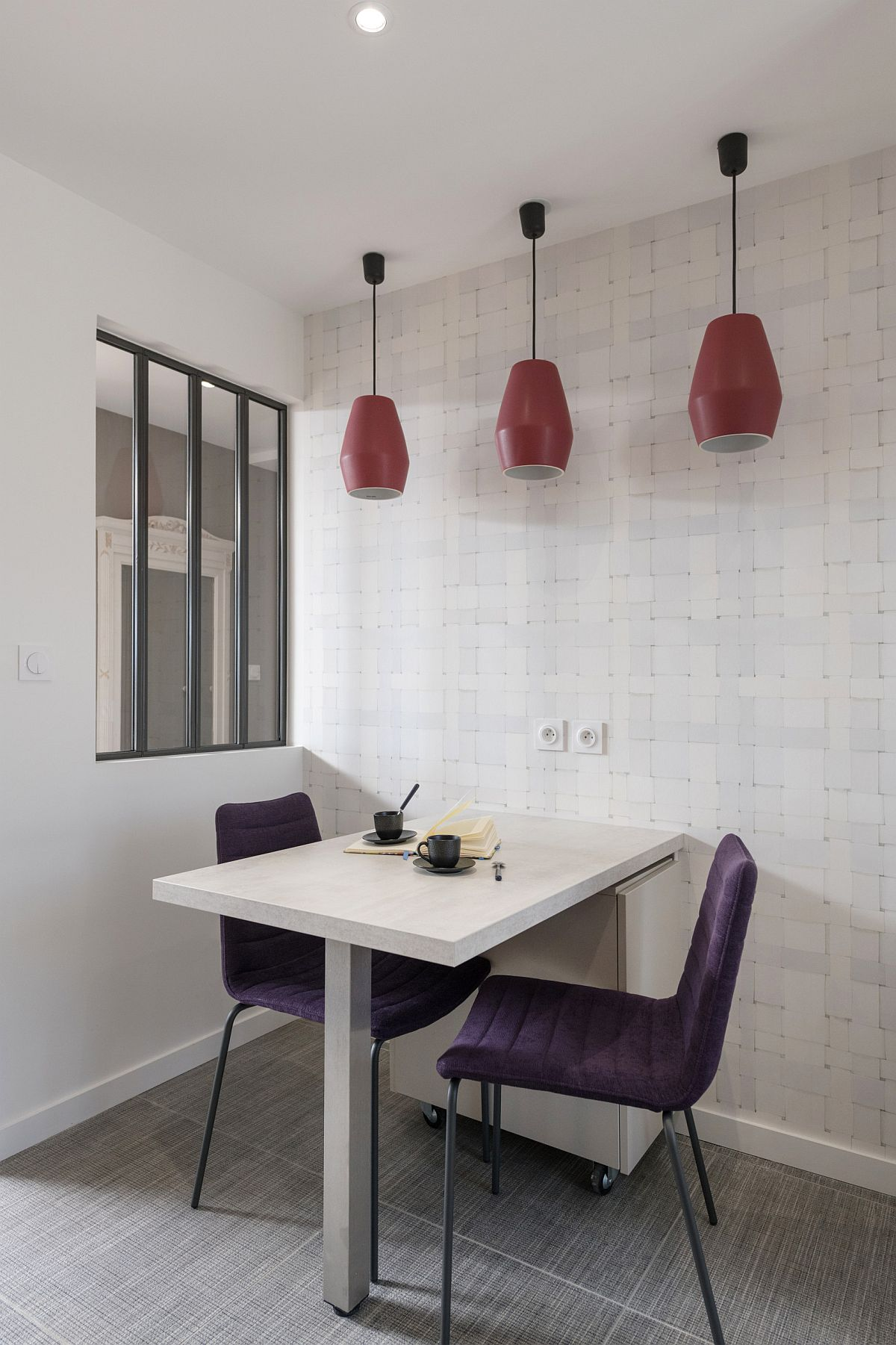 Red-pendants-add-color-and-contrastto-the-minimal-dining-room-in-white-10597