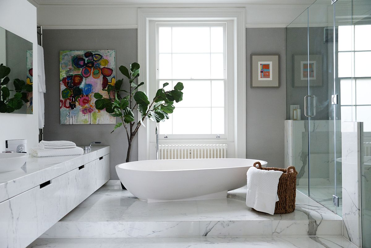 Refined and elegant contemporary bathroom of London home in gray and white oozes luxury