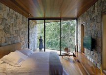 Relaxing-retreat-bedroom-in-wood-and-stone-offers-unabated-views-of-the-landscape-36059-217x155