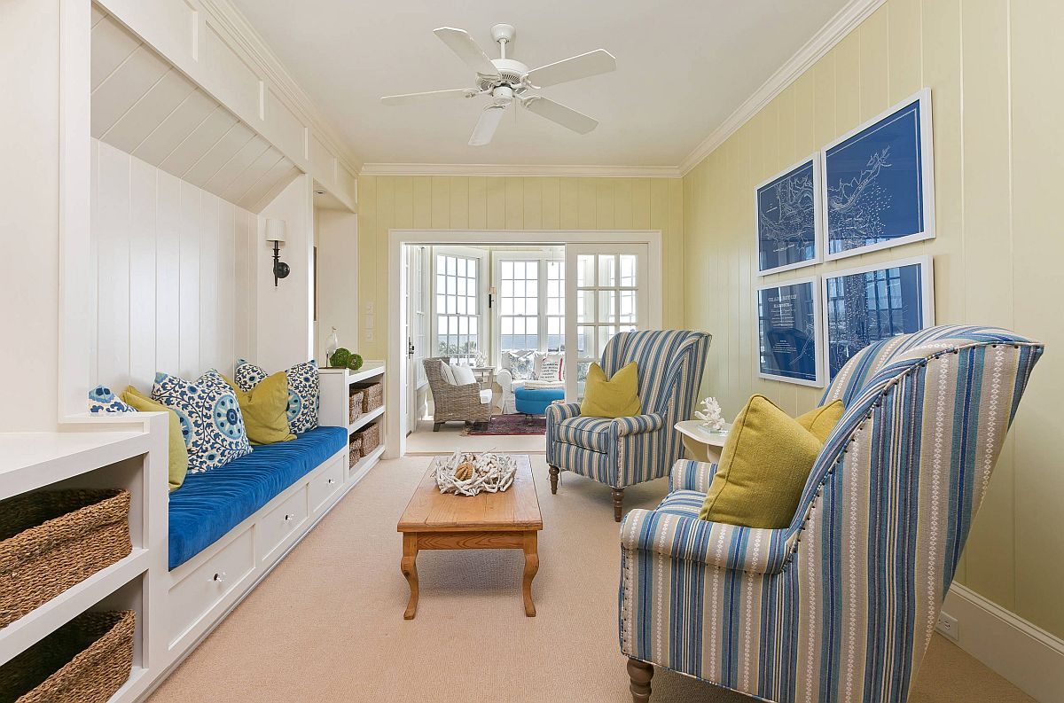 Remodeled modern beach style living room in light yellow and blue is a showstopper