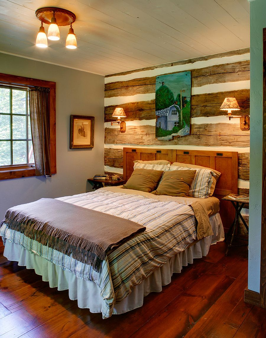 Repurposed wooden wall in the backdrop of this rustic bedroom captures your attention with unique pattern