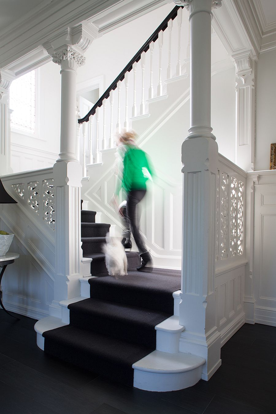 Revamped interior of the house in white with a traditional staircase