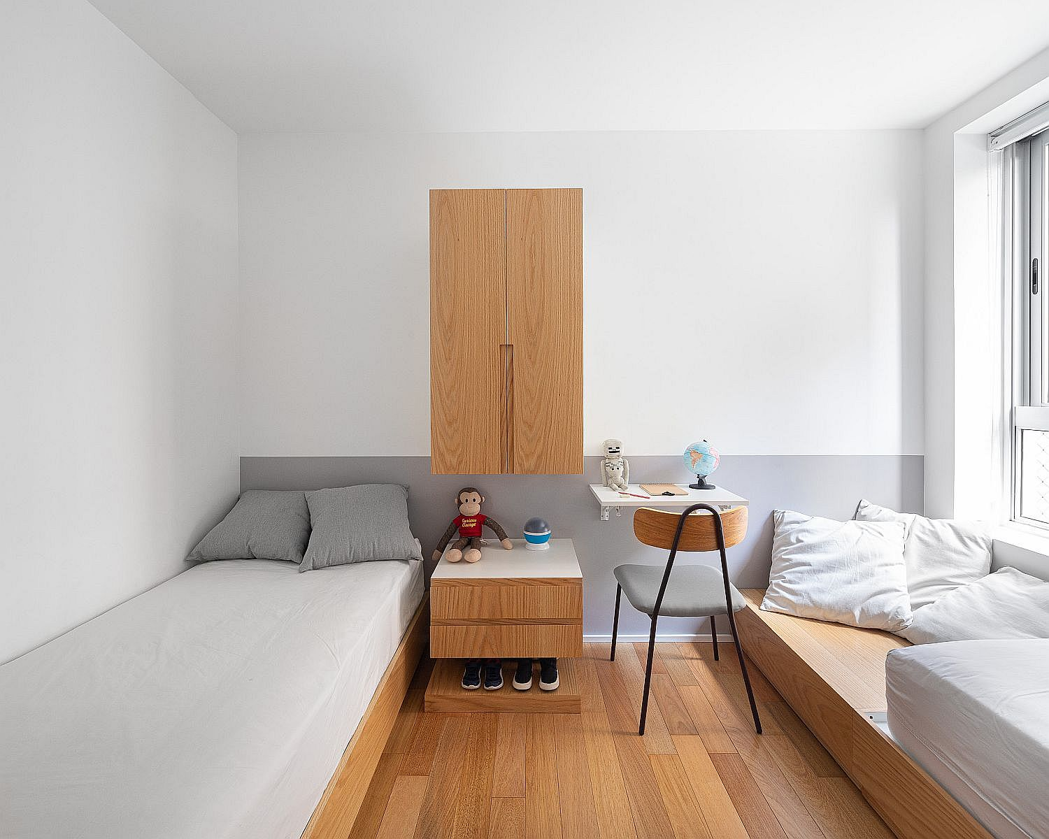 Simple and minimal design of the kids' room and guest space with wooden beds and benches