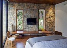 Simple-floating-wooden-desk-se-against-stone-walls-inside-the-bedroom-93288-217x155