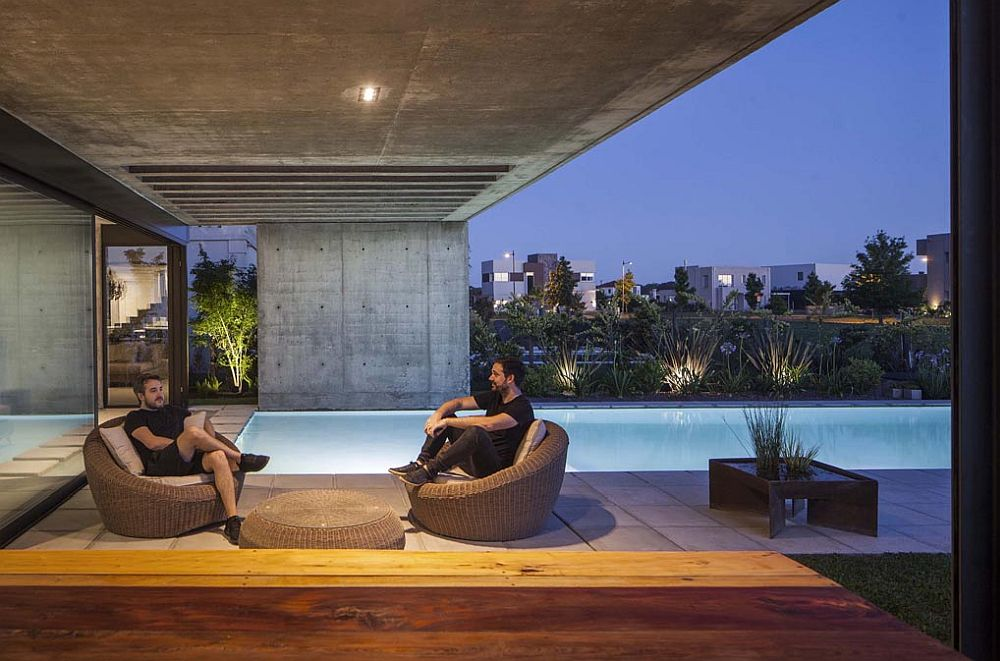 Sitting-area-outside-the-house-next-to-the-pool-also-is-sheltered-from-direct-sunlight-81356