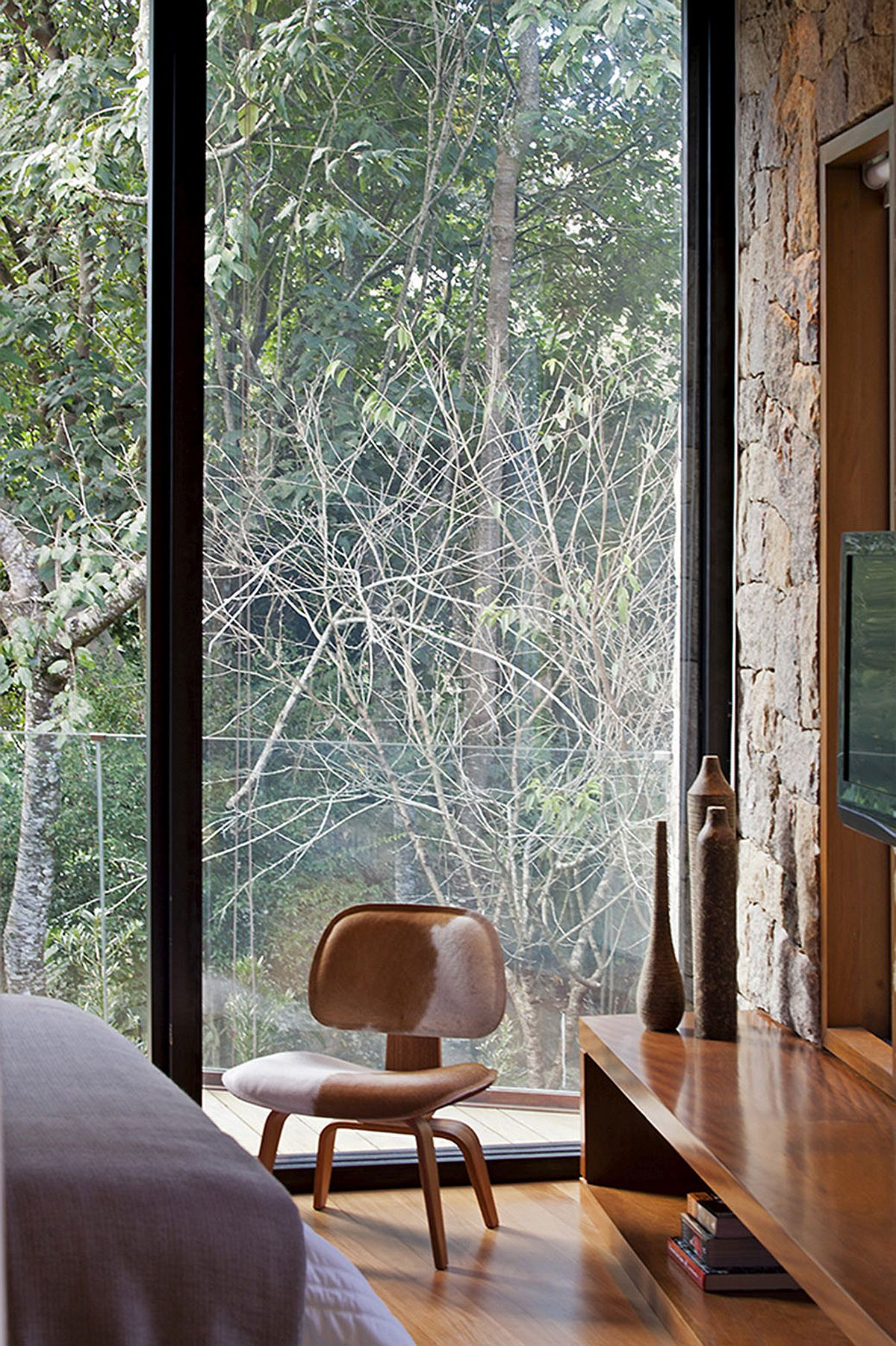 Sliding glass walls bring nature into the bedroom with ease