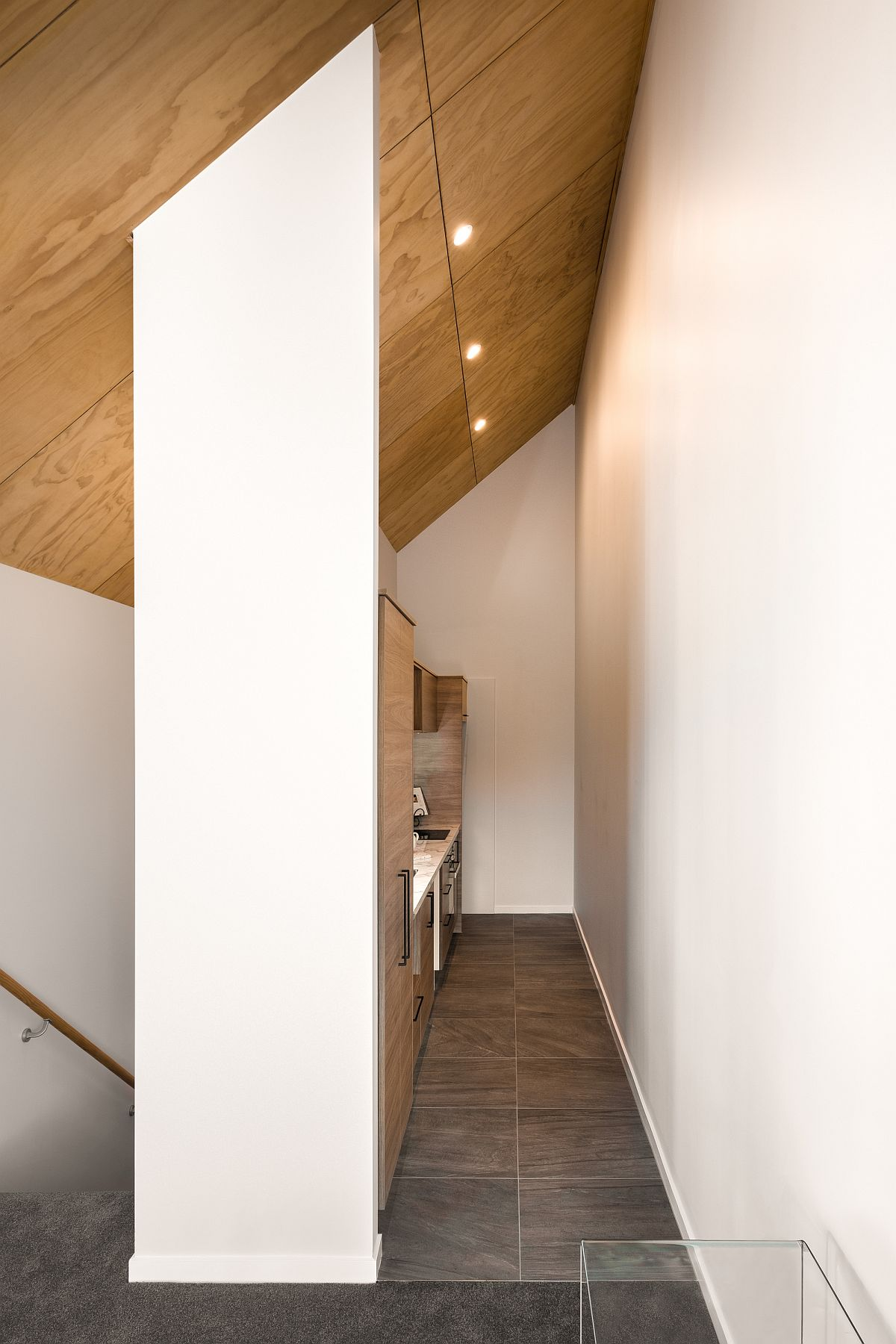 Small and narrow kitchen in wood and white