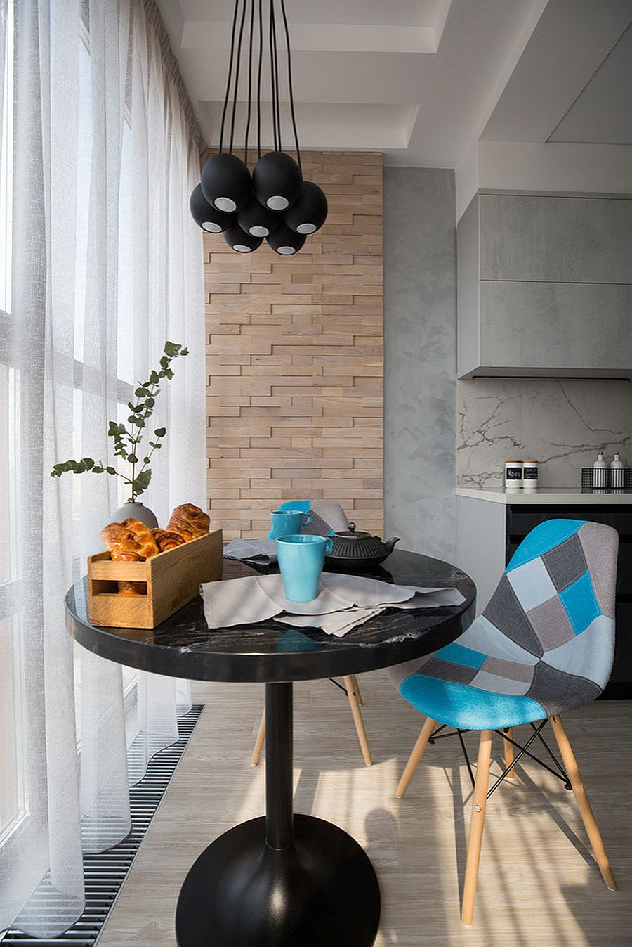 Small-dark-dining-table-coupled-with-black-pendants-in-the-tiny-dining-area-77599