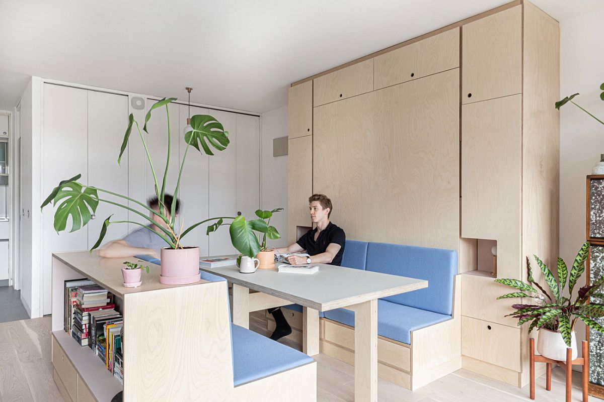 Small modern studio apartment in Barbican, London with multi-functional decor that completely transforms it