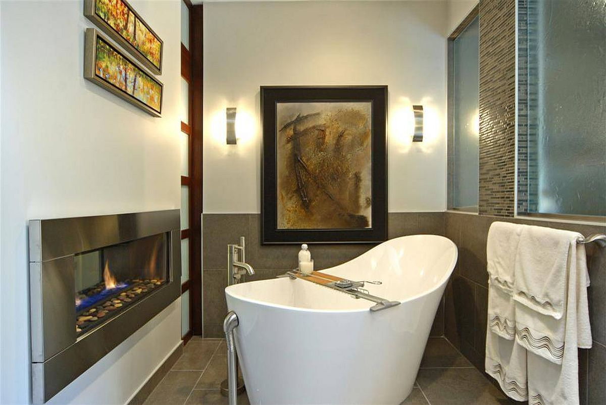 Soaking tub next to the fireplace inside this modern classic bathroom is the perfect place to relax after a long day