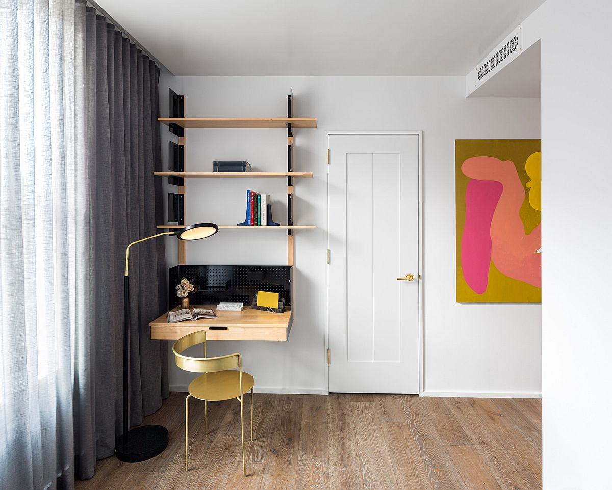 Space-savvy home office in the corner with a floating desk and minimal design