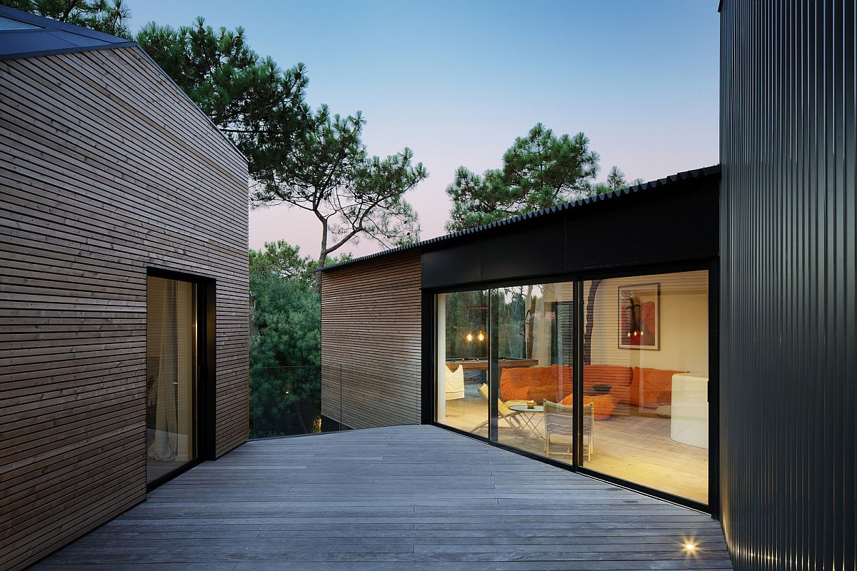Spacious wooden deck connects the two cabins inside the Holiday Home in France