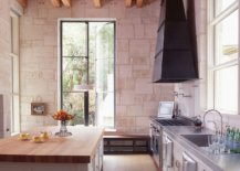 Stone-along-with-wooden-countertops-gives-this-modern-kitchen-a-traditional-appeal-64547-217x155
