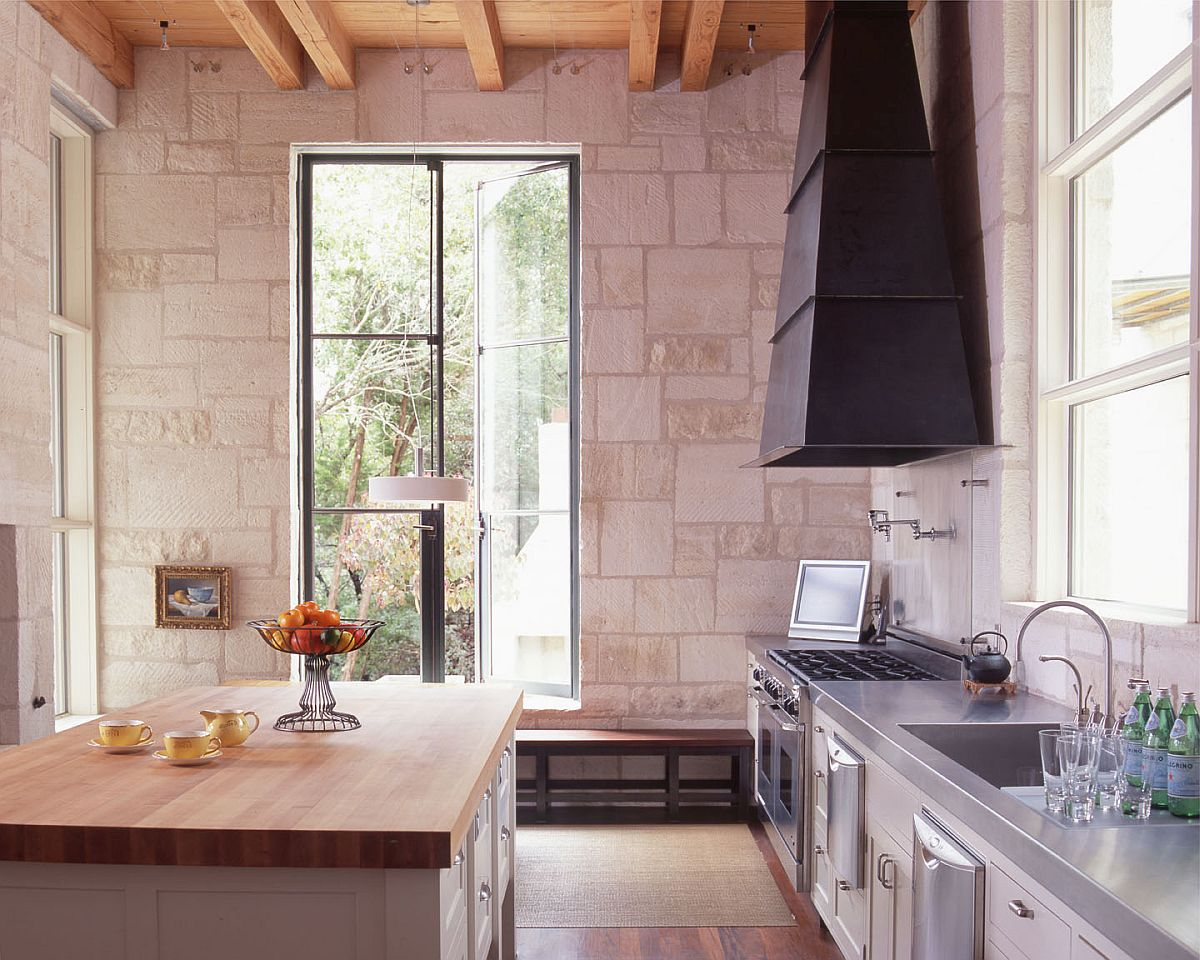 Stone along with wooden countertops gives this modern kitchen a traditional appeal