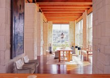 Stone-and-glass-walls-along-with-wooden-ceiling-give-the-interior-a-cozy-and-classic-appeal-72053-217x155