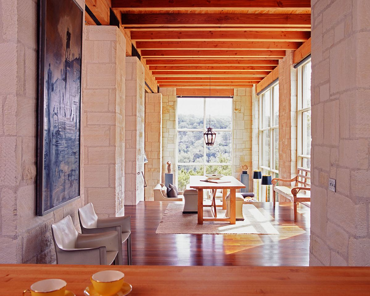 Stone-and-glass-walls-along-with-wooden-ceiling-give-the-interior-a-cozy-and-classic-appeal-72053