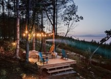 String-lighting-gorgeously-illuminates-the-small-deck-that-overlooks-distant-sea-and-the-forest-all-around-63062-217x155