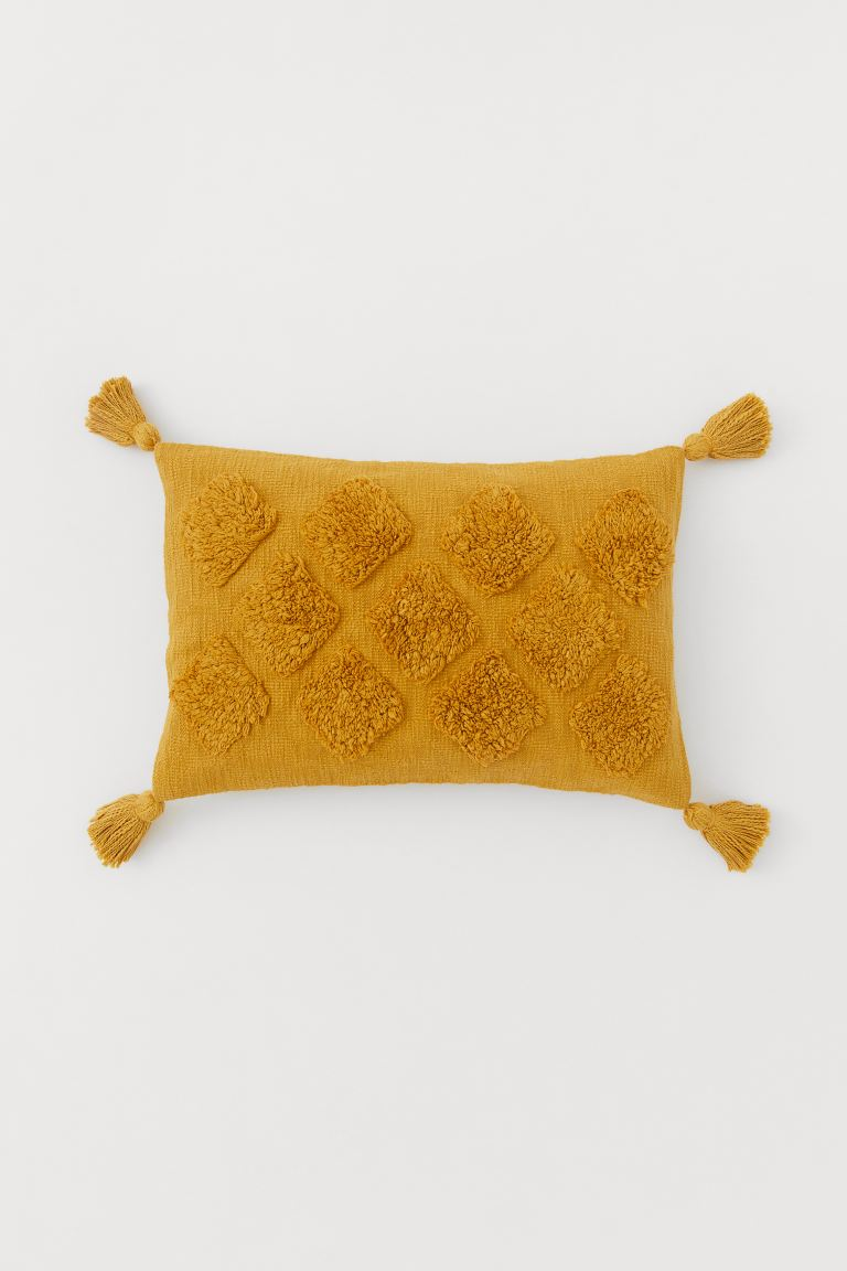 Textured cushion cover with tassels