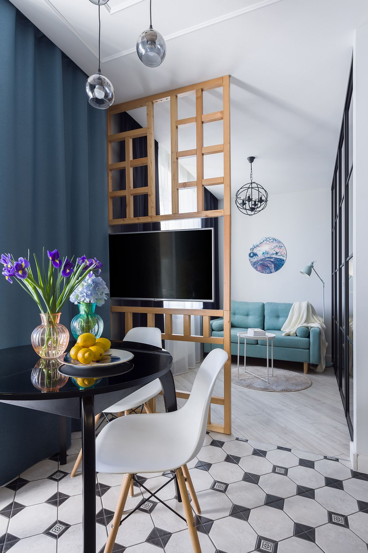 Tiny-dining-area-in-the-small-apartment-with-black-dining-table-and-a-couple-of-chairs-99316