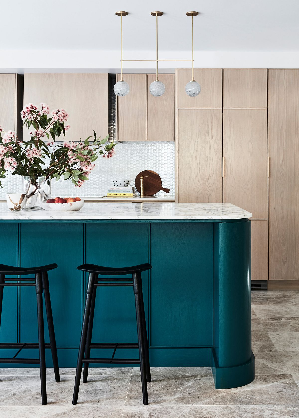 Touch of teal for the kitchen island brings color to the neutral space in white and gray