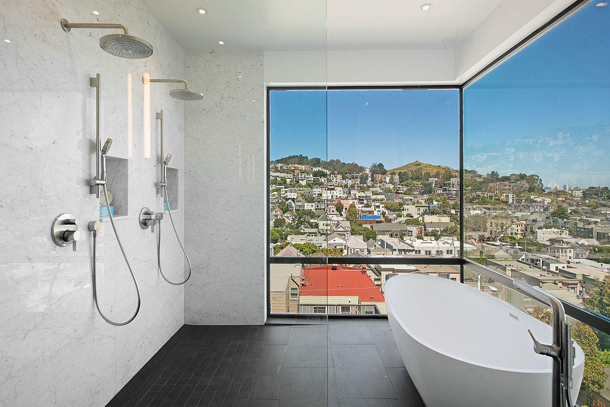 Trendy and stylish bathroom with twin rainfall showerheads and a freestanding bathtub