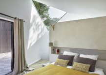 Triangular-cutouts-bring-natural-light-into-the-bedroom-on-the-upper-level-clad-in-white-65820-217x155