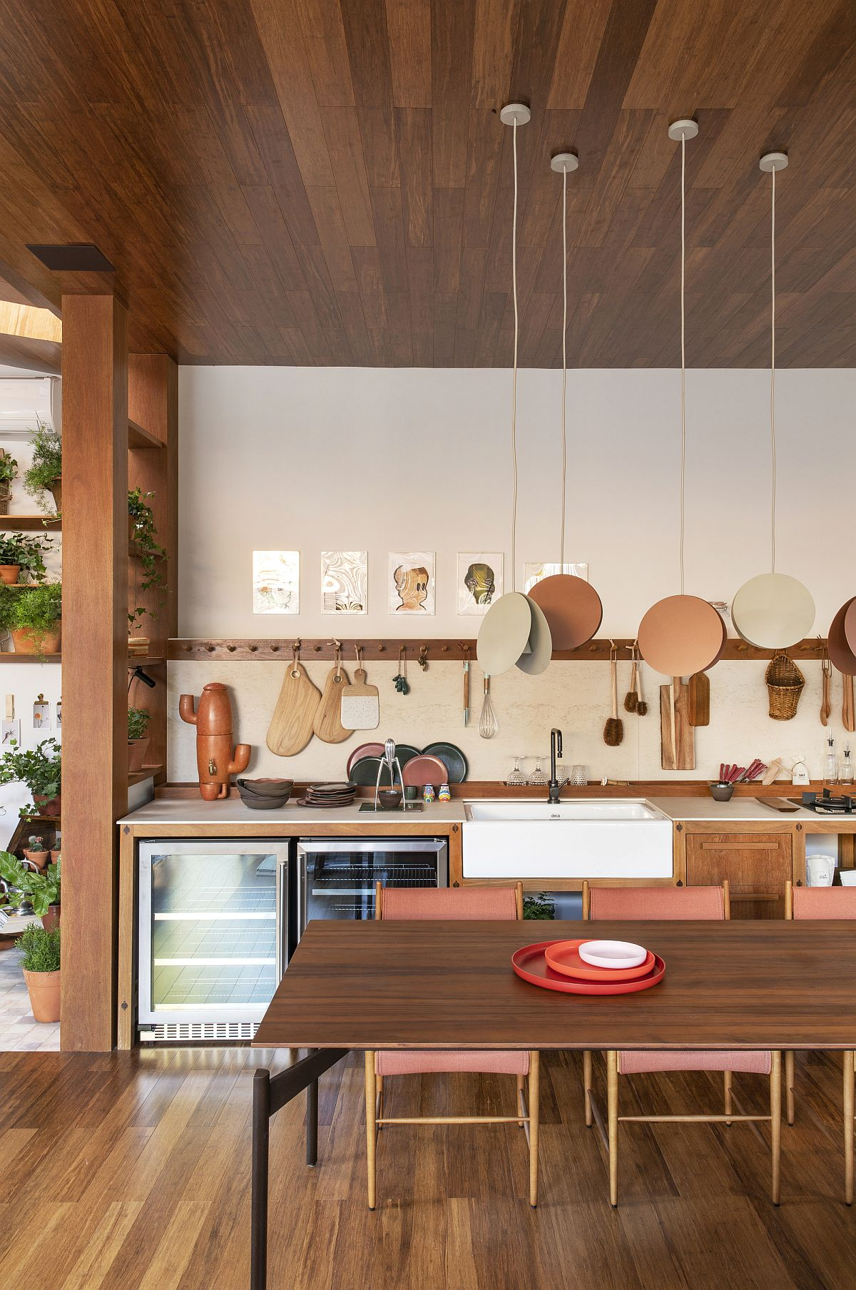 Unique pendant lights illuminate the dining area and blend into the backdrop