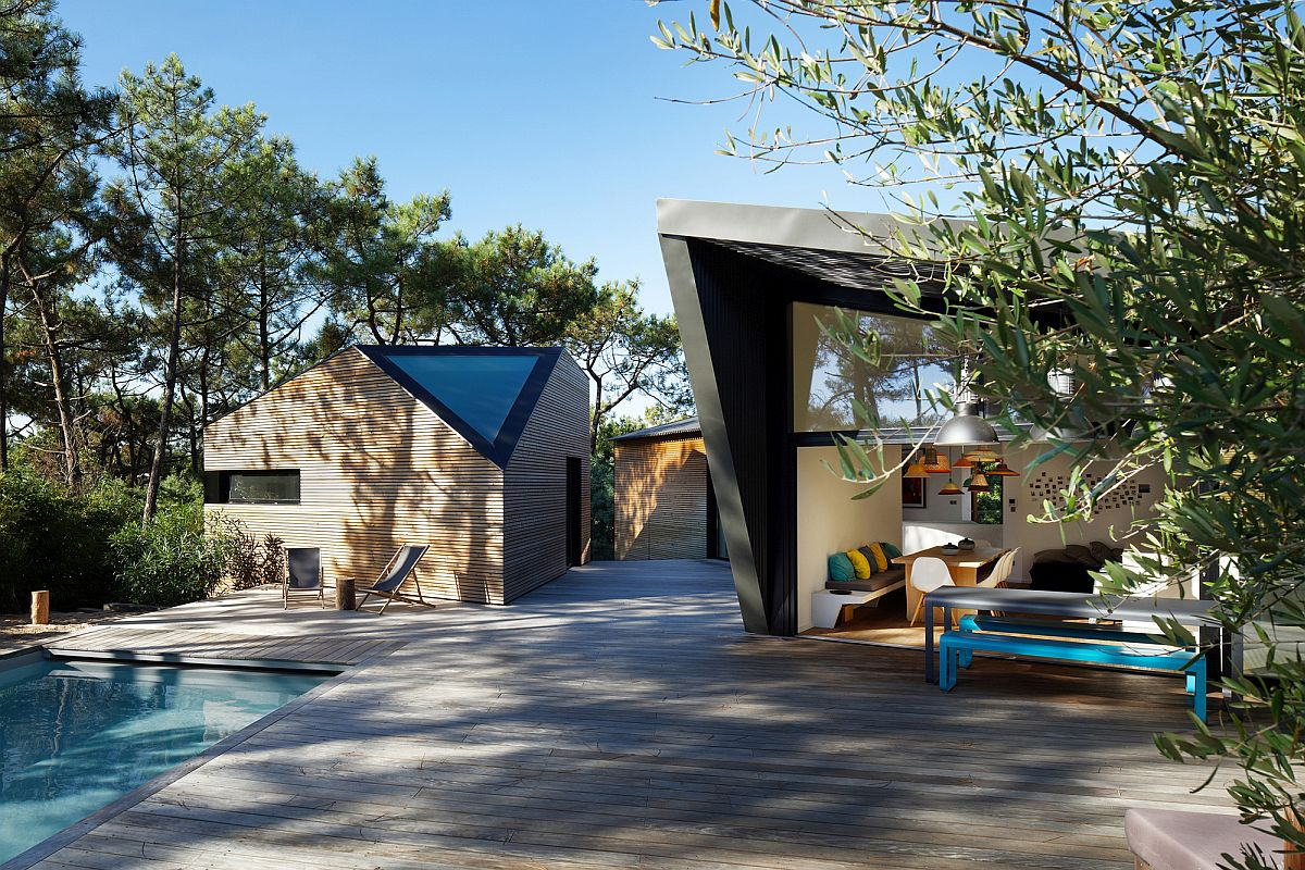 Unique triangular windows and openings bring geometric style to the fabulous holiday home