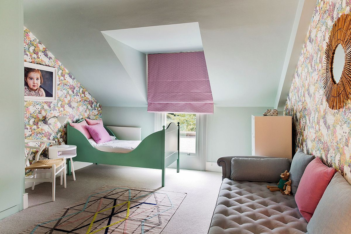 Wallpaper brings flowery pattern to this bright girls' bedroom in white and pastel hues