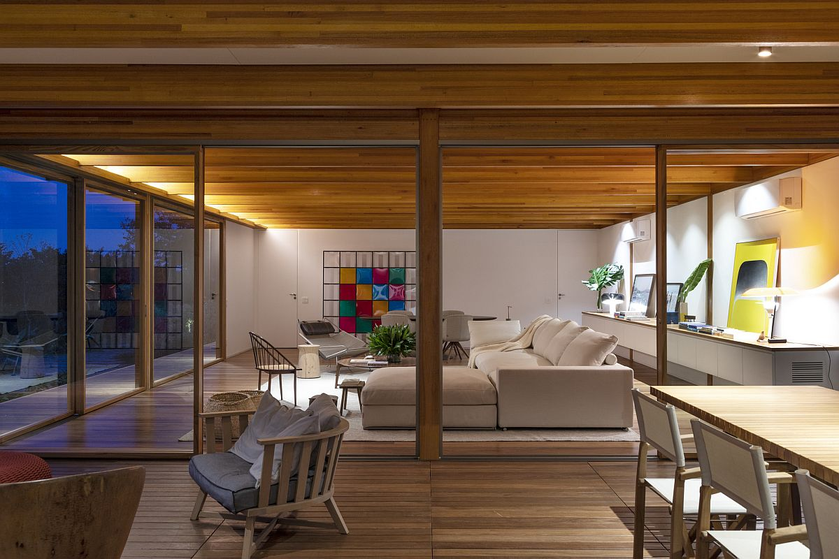 Warm lighting adds to the cozy appeal of wood inside the open living area