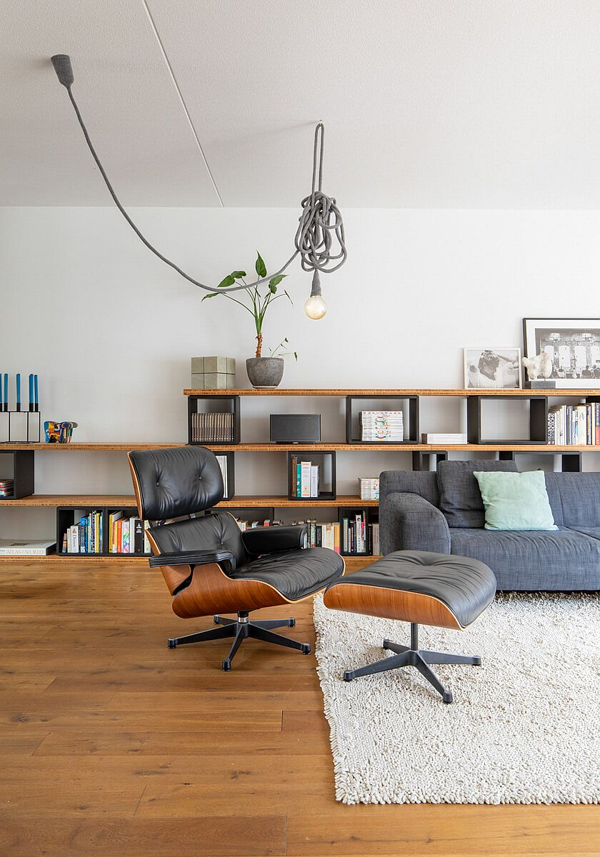 White and wood living area with the classic Eames Lounger at its heart