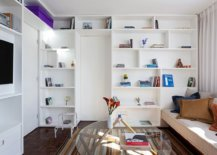 White-bookcase-inside-the-tiny-Brazilian-apartment-hides-door-to-the-bedroom-that-is-hidden-behind-96873-217x155