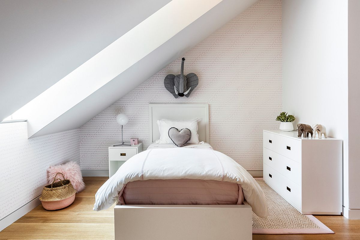 White contemporary bedroom in attic with a hint of pastel pink thrown into the mix