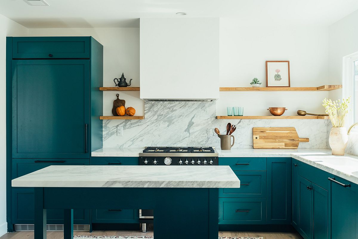 White marble finishes combined with bright teal cabinets inside the gorgeous modern kitchen