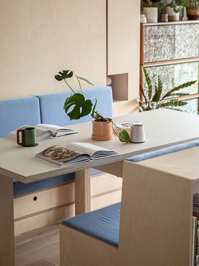 Wood and blue bench and seating becomes the heart of the new apartment interior