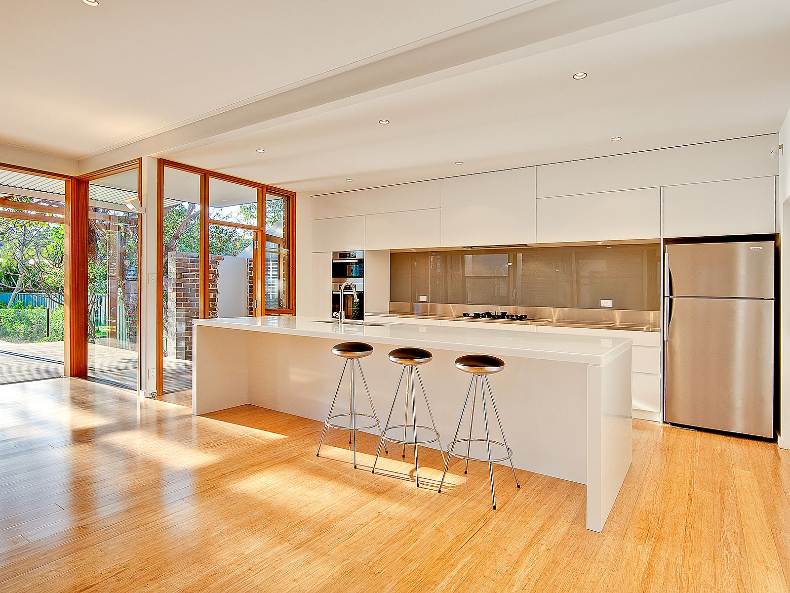 Wood-and-white-kitchen-of-the-Sydney-house-connected-with-the-wooden-deck-outside-70089