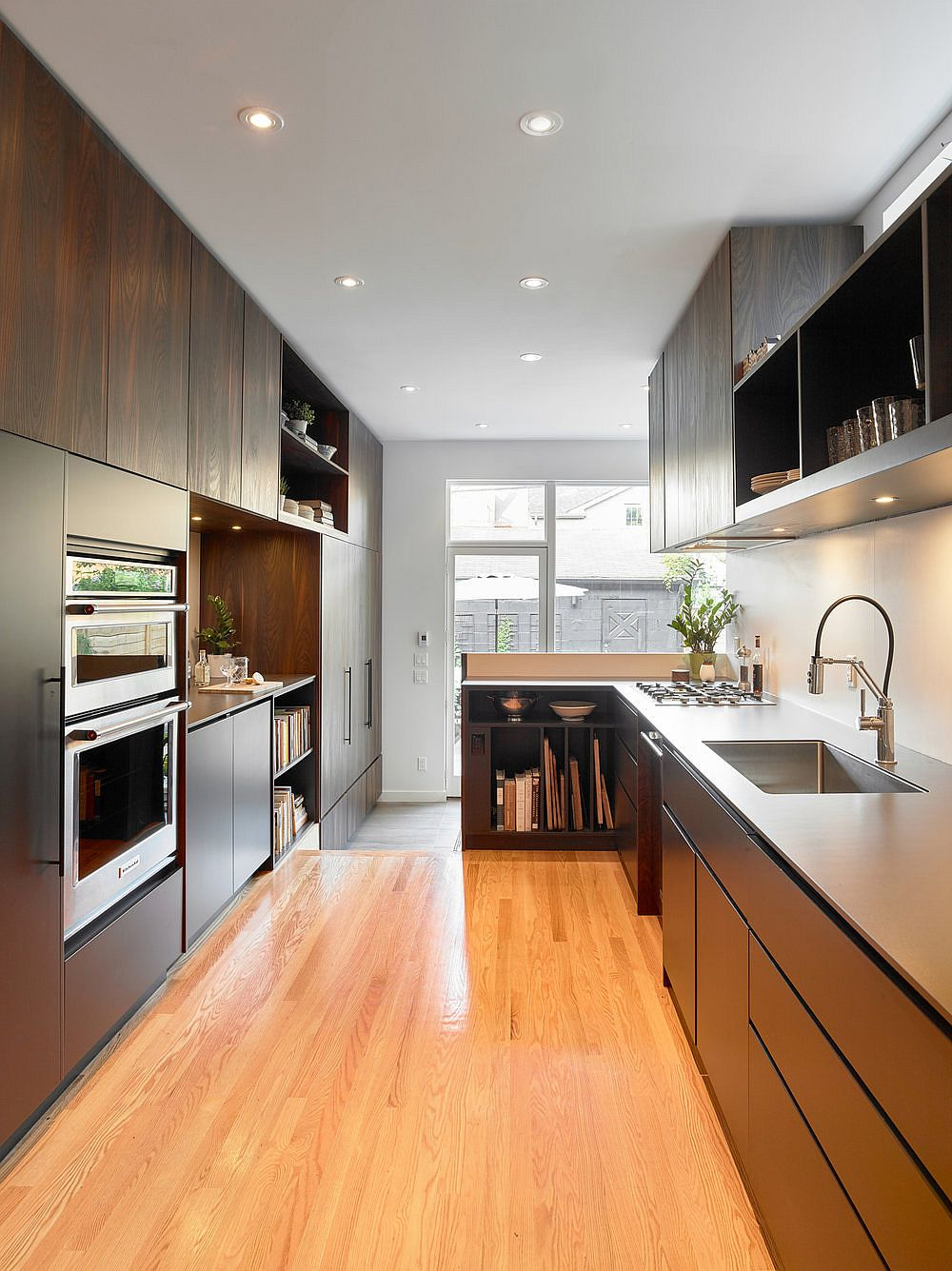 Wood and white kitchen of the Toronto home with a modern traditional style