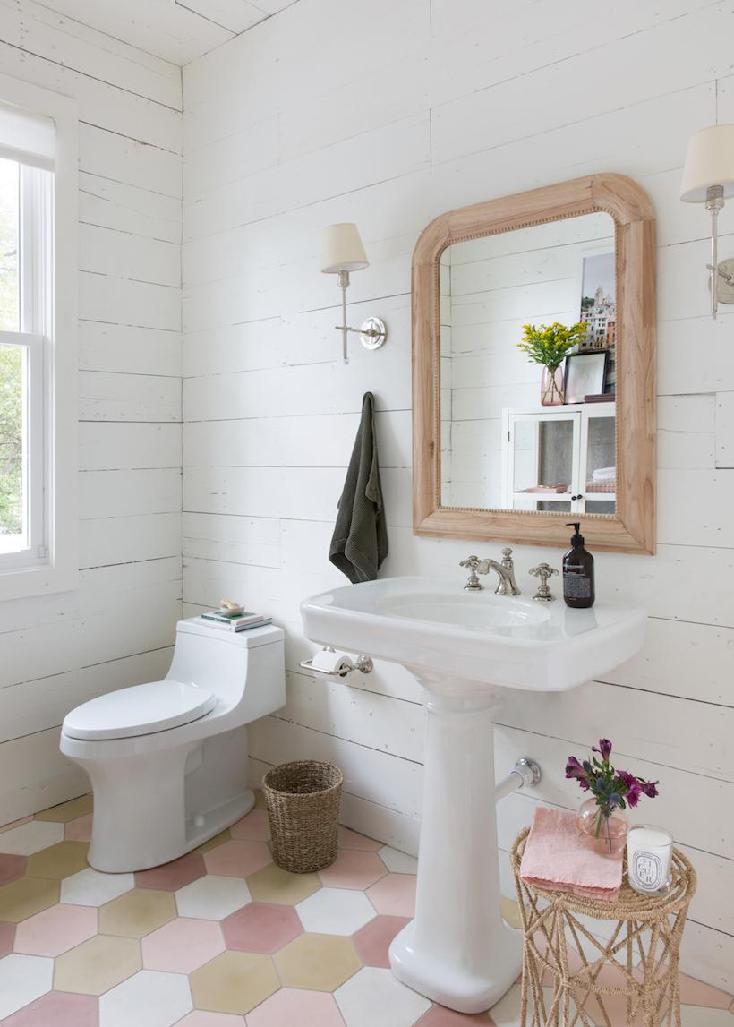 Wooden bathroom mirror in a bathroom with white shiplap